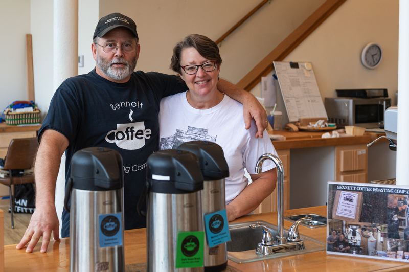 PMG PHOTO: CHRISTOPHER OERTELL - Mark and Rene Bennett, co-owners of Bennett Coffee Roasting Co., stand behind the counter at their business in downtown Hillsboro.