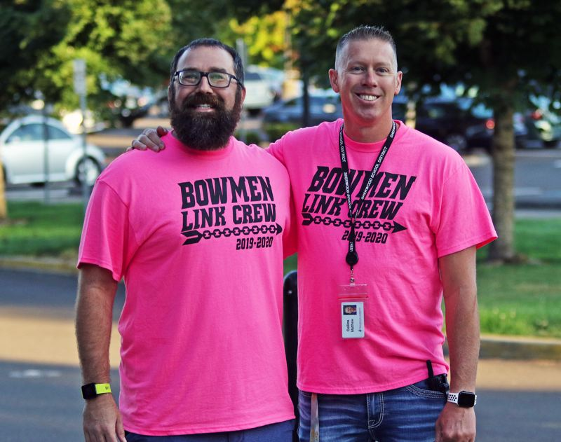 PMG PHOTO: DAN BROOD - Math teacher Dave Kilian (left) and associate principal Matt Collins get ready to greet incoming freshmen Tuesday, during the first day of classes at Sherwood High School.