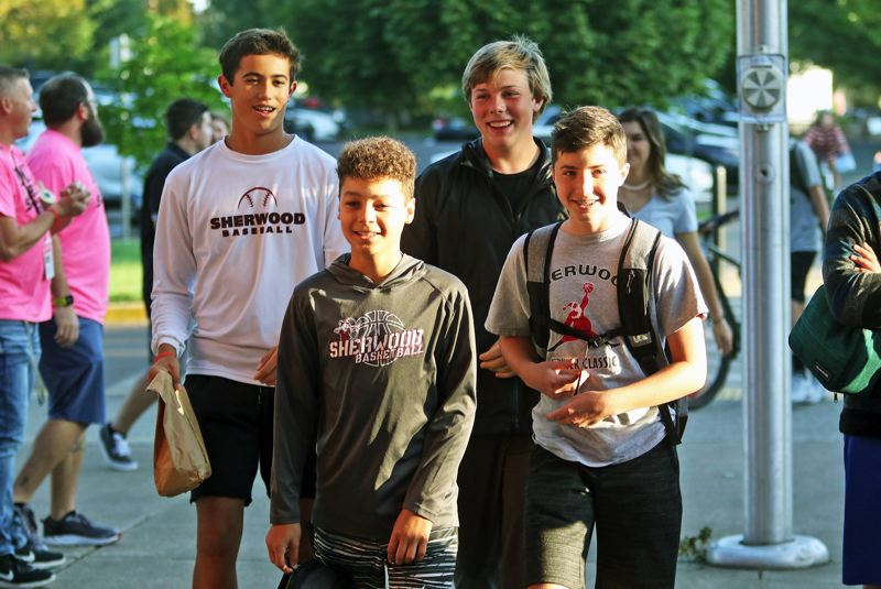 PMG PHOTO: DAN BROOD - Incoming freshmen get ready to enter the building on Tuesday for the first day of classes at Sherwood High School.