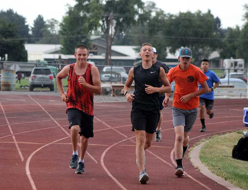 STEELE HAUGEN - Culver cross country runner Evan Powell, center, leads the pack for the new Bulldogs cross country team.