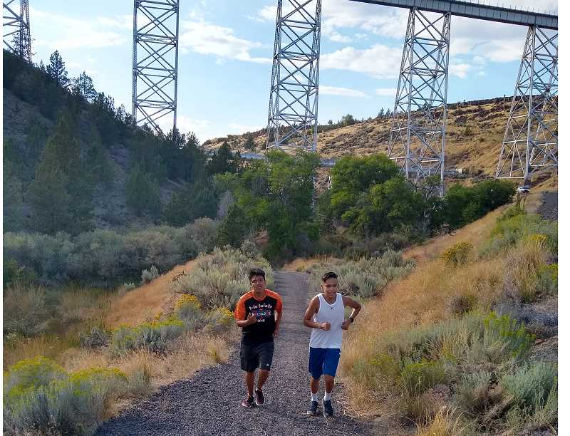 SUBMITTED PHOTO - Leander Smith (left) and Isaiah Wapsheli (right) run on the Willow Creek Canyon Trail to get ready for the season.