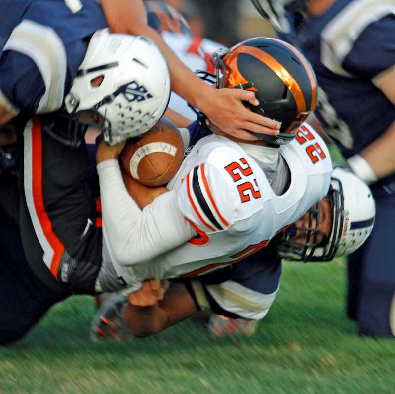 PMG FILE PHOTO - Even a hard tackle to the body can jar the brain, as can repeated minor contact with a helmet.