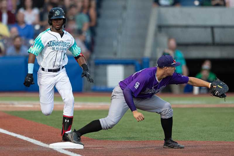 PMG PHOTO: CHRISTOPHER OERTELL - Hillsboro Hops infielder Liover Peguero races to first base following an groundball during the Hops' game against Boise Thursday, Aug. 29, at Ron Tonkin Field in Hillsboro.