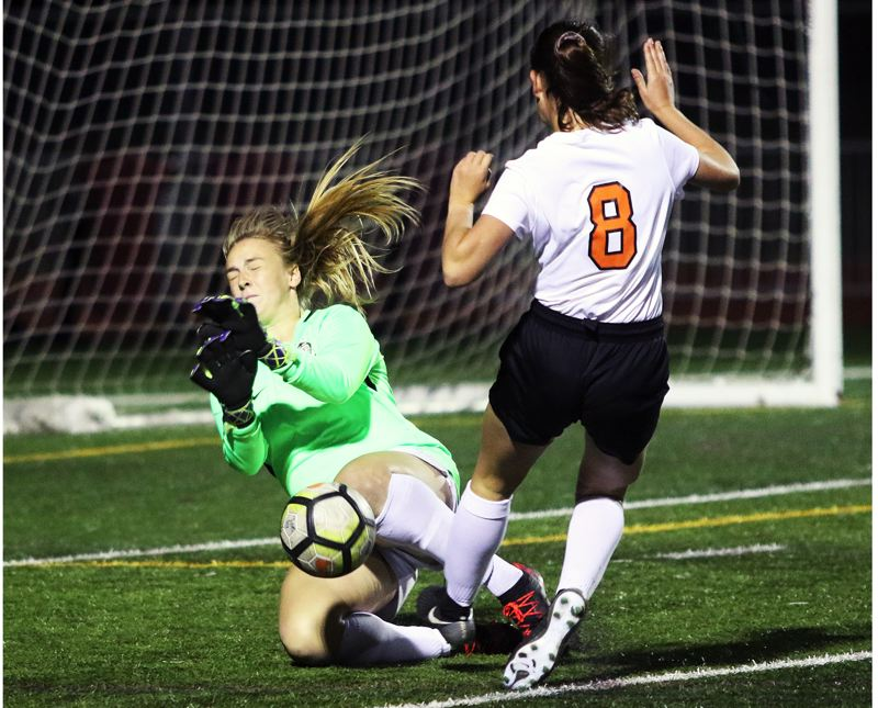 PMG FILE PHOTO: DAN BROOD - Tualatin senior goalkeeper Sarah Hall (left) is one of three captains for the Timberwolves for the 2019 season.