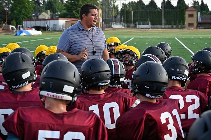 PMG PHOTO: CHRISTOPHER OERTELL - Glencoe second-year head coach Ian Reynoso talks to his team during a preseason practice last week at Glencoe High School.