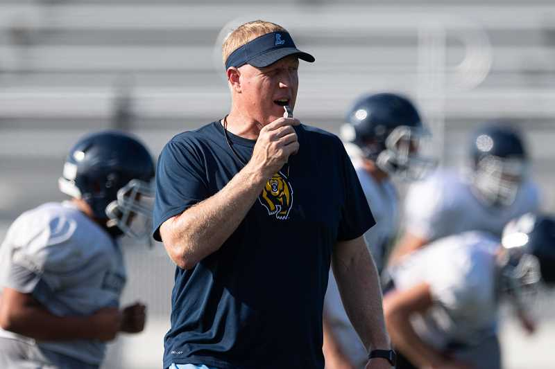 PMG PHOTO: CHRISTOPHER OERTELL - Liberty head football coach Eric Mahlum during a Falcons preseason practice at Liberty High School.