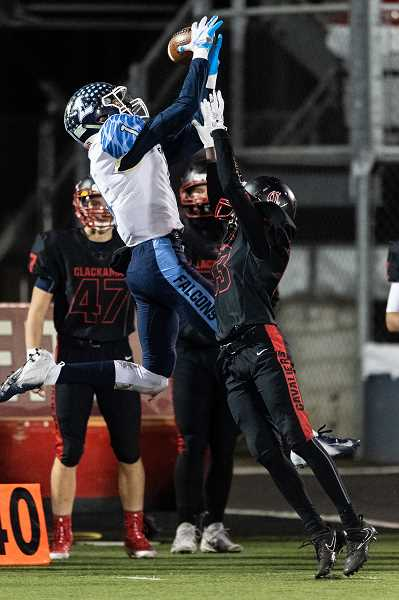 PMG PHOTO: CHRISTOPHER OERTELL - Liberty's Marquis Brown goes up for a catch during last year's state quarterfinal game with Clackamas at Clackamas High School. Brown was the Pacific Conference Defensive Player of the Year last season.