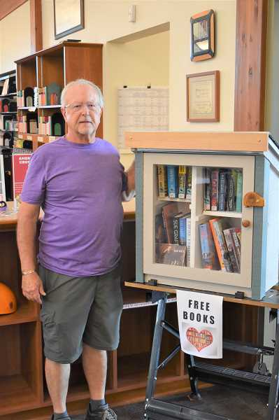 PMG PHOTO: EMILY LINDSTRAND - Dennis Weber built a Little Free Library that will be at the Estacada Public Library for the next month. He hopes the project encourages others to build Little Free Libraries of their own.