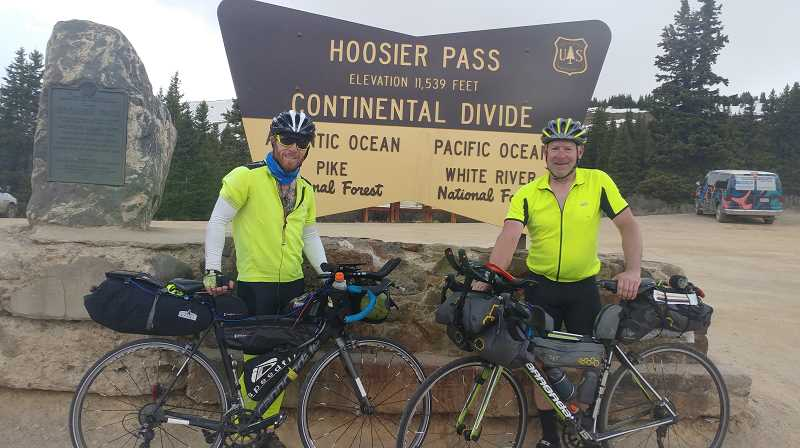COURTESY PHOTO: VICTOR HARSHMAN - Clackamas County Park Ranger Victor Harshman and his nephew, James Campbell, take a break from their bike ride across the country at Hoosier Pass in Colorado.