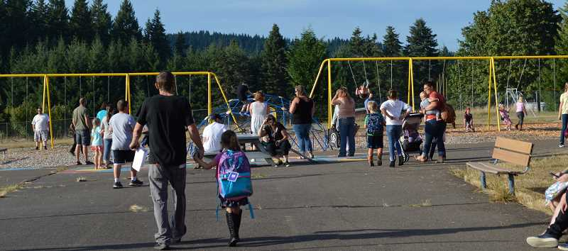 PMG PHOTO: CINDY FAMA - The new swing set is the place to be at back-to-school night Aug. 29.
