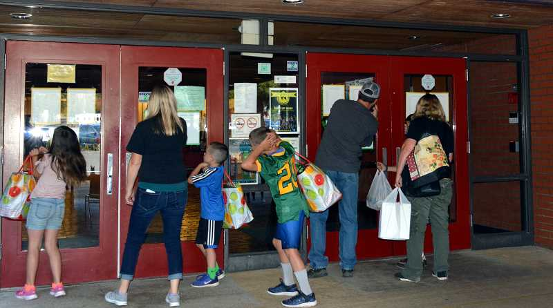 PMG PHOTO: CINDY FAMA - The class lists on the doors make the entrance way a favorite spot at back-to-school night on Aug. 29.