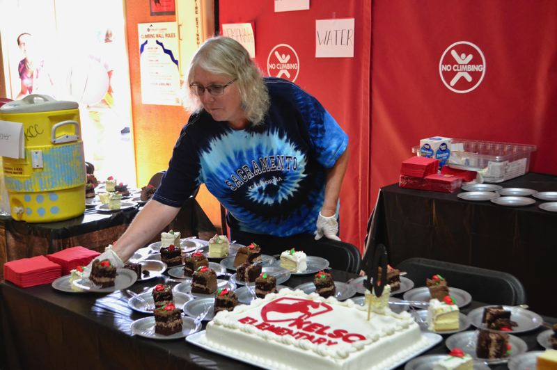 PMG PHOTO: BRITTANY ALLEN - Birthday cake was offered to celebrate Kelso Elementary's 40th year at the back-to-school event.
