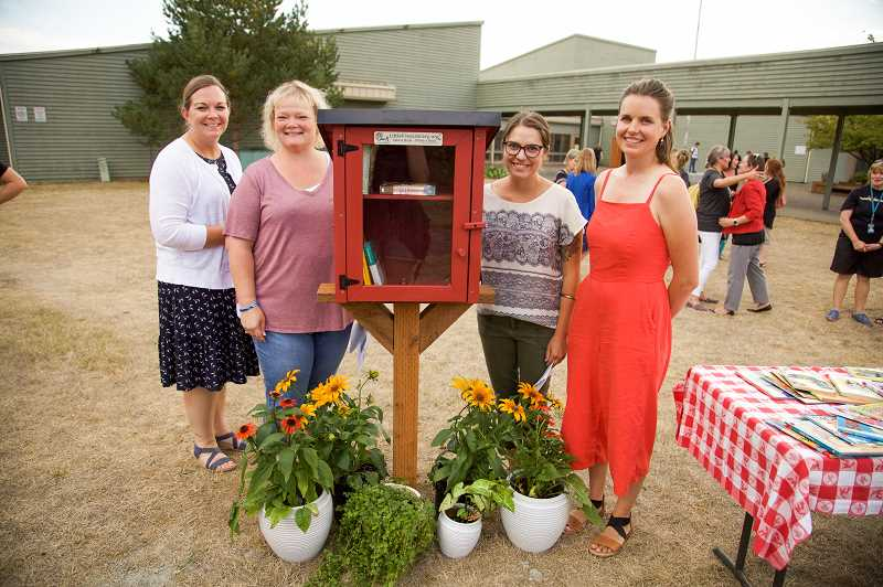 COURTESY PHOTO: KATI BODLE, CREATIVE JUICES PHOTOGRAPHY - Four of Barbara Sandgren's granddaughters spoke at the dedication of the Little Free Library on Aug. 28. They are, from left: Megan Pearce, Jen Boswell, Heidi Sandgren and Anna Sandgren.