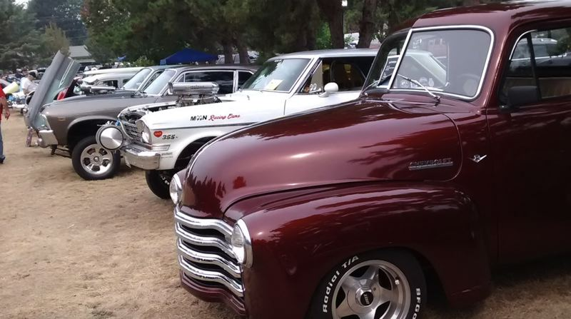 PMG PHOTO: BRITTANY ALLEN - Car owners come from all over to showcase their rides at the St. Michael's Catholic Church's Sandy Cruisin' Car Show.