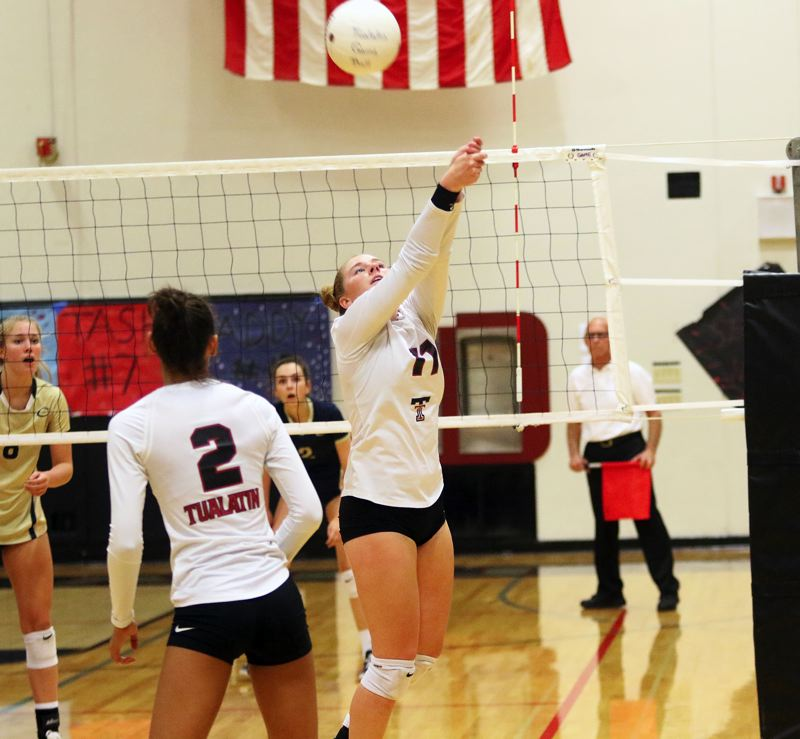 PMG FILE PHOTO: DAN BROOD - Tualatin High School senior setter Jackie Phillips (11) was an all-Three Rivers League first-team selection last year as a junior.