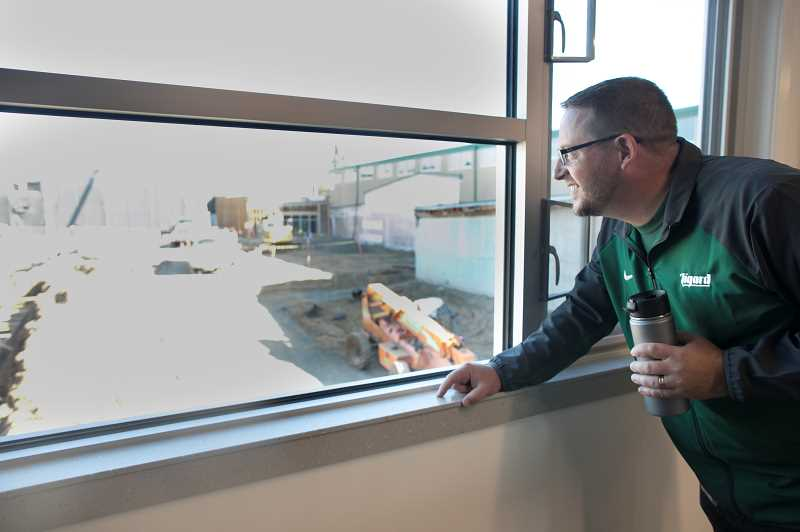 PMG PHOTO: JAIME VALDEZ - New Tigard High School Principal Brian Bailey takes a look at the continued construction at the high school, which should be complete in 2020.