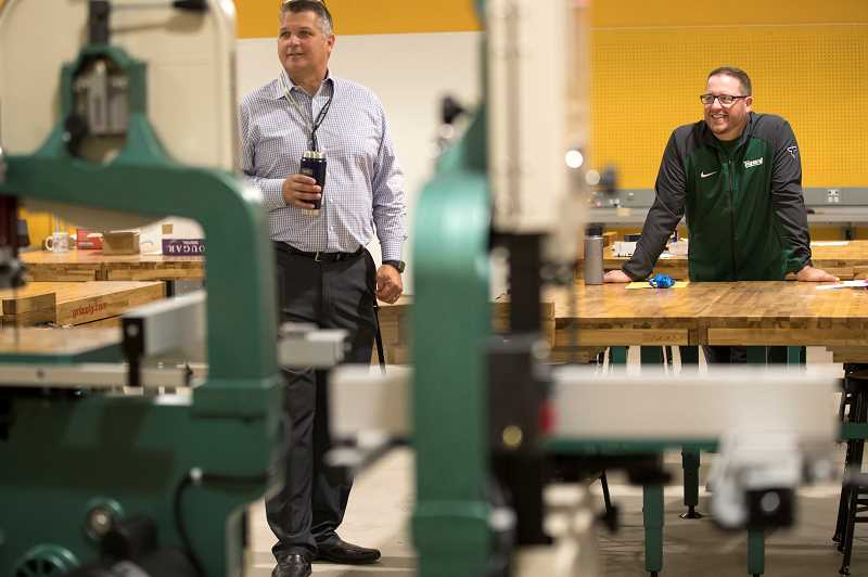PMG PHOTO: JAIME VALDEZ - Darren Barnard, director of operations and bond for the Tigard-Tualatin School District, left, and new Tigard High School Principal Brian Bailey, survey a new wood shop room. The district has been without a wood shop class for years but is restarting the program thanks to money from a Tigard-Tualatin School District bond and Ballot Measure 98, passed by voters in 1998, which in part supports career and technical education.