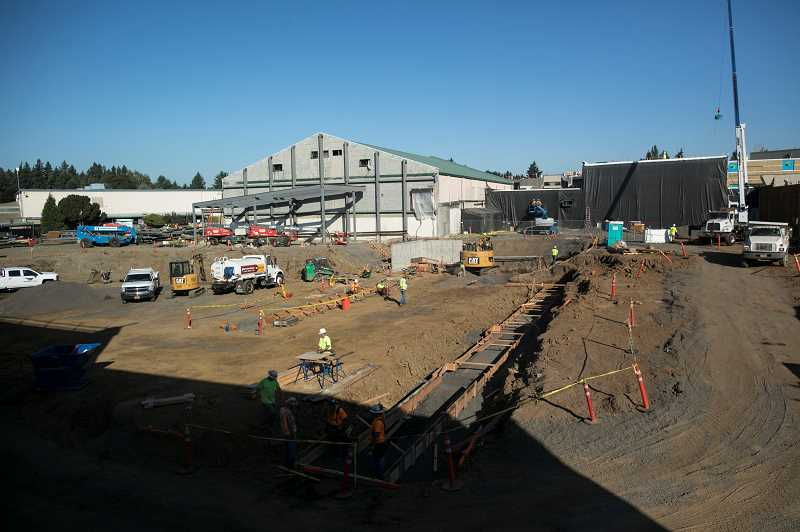 PMG PHOTO: JAIME VALDEZ - The main gym to the left will remain intact during the construction/renovation process while the old auxiliary gym will be torn down and rebuilt. Meanwhile, the commons area, shown shrouded in black, will make its way south during the school year with students able to witness its progress.