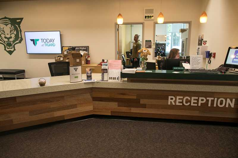 PMG PHOTO: JAIME VALDEZ - A new reception/administrative area at Tigard High School includes reclaimed wood taken from some of the structures that have been torn down during renovation.