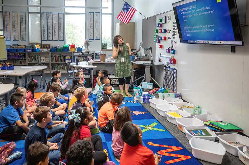 PMG PHOTO: JONATHAN HOUSE - Second graders in Karen Lokting-Montgomery's class at William Walker Elementary learn about the rules on the new campus.
