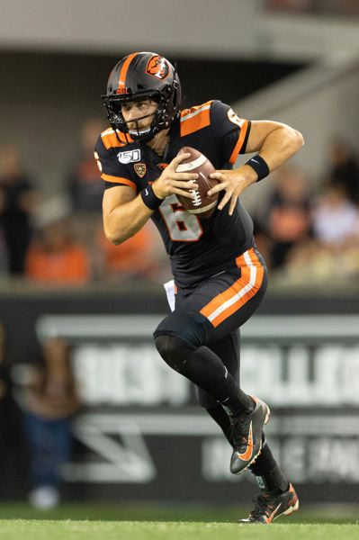 PMG PHOTO: CHRISTOPHER OERTELL - Oregon State quarterback Jake Luton takes off with the ball during the season opener last week against Oklahoma State.
