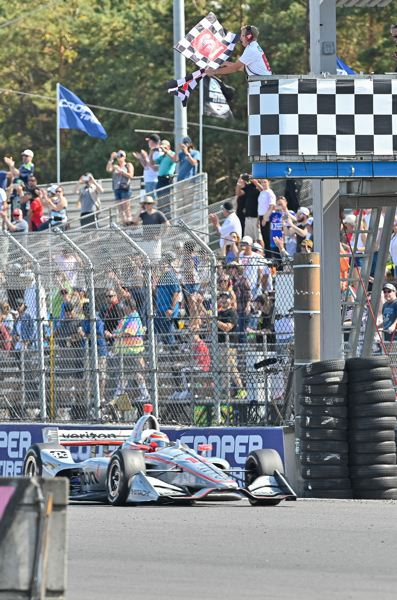 PMG PHOTOS: CHRISTOPHER OERTELL - Will Power takes the checkered flag in his Verizon Team Penske Chevrolet as he wins the IndyCar Grand Prix of Portland.