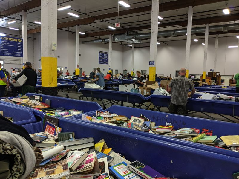 PMG PHOTO:  JOSEPH GALLIVAN  - Shopping by the pound at the Goodwill Industries of the Columbia and Willamette outlet store, AKA the Sellwood Bins. Booksellers with barcode scanners do well here.