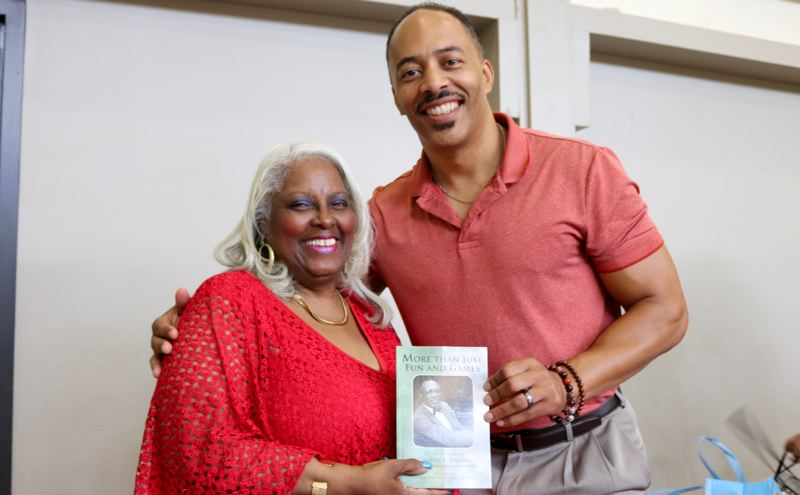 PMG PHOTO: ZANE SPARLING - Michelle Harper and Dion Jordan posed for a photo during a birthday celebration for Commissioner Charles Jordan in Portland.