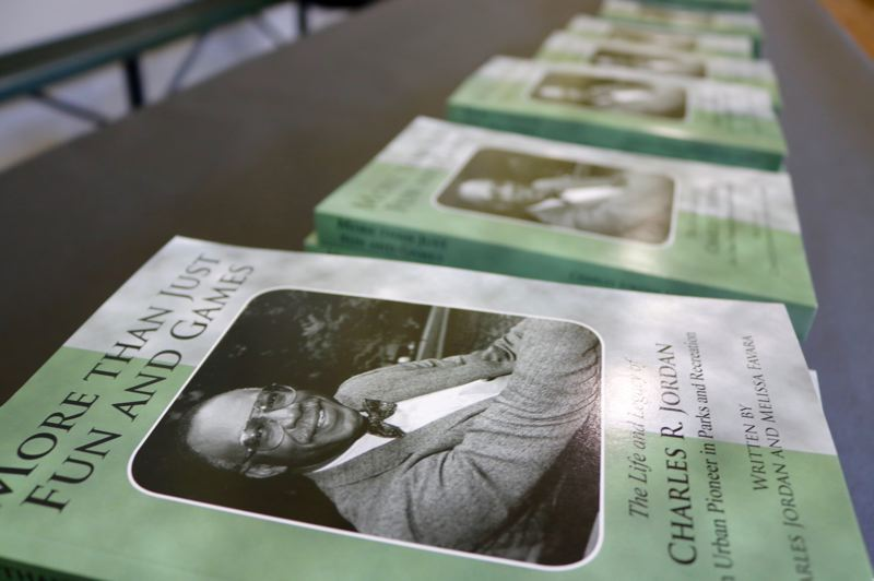 PMG PHOTO: ZANE SPARLING - Copies of Portland City Commissioner Charles Jordan's book were for sale during a birthday celebration at the North Portland community center renamed in his honor on Saturday, Aug. 31.
