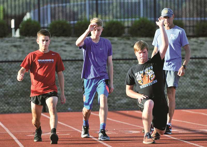 GRAPHIC PHOTO: GARY ALLEN - Led by longtime coach Bruce Sinkbeil, the Newberg cross-country team has been training hard for the fall.