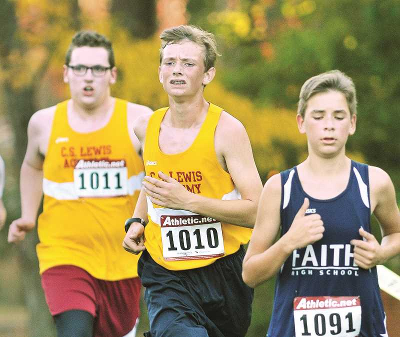 GRAPHIC FILE PHOTO - Sophomores Matt Oliver (left) and Nicolas Hurst (center) comprise the C.S. Lewis Academy boys cross-country team.