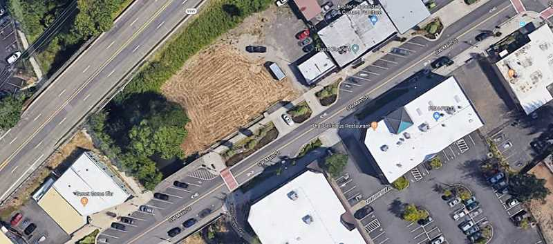 COURTESY CITY OF TIGARD - The field in this photo will be the future home of extended operations for an Ava Roasteria coffee business as well as three floors of apartments.