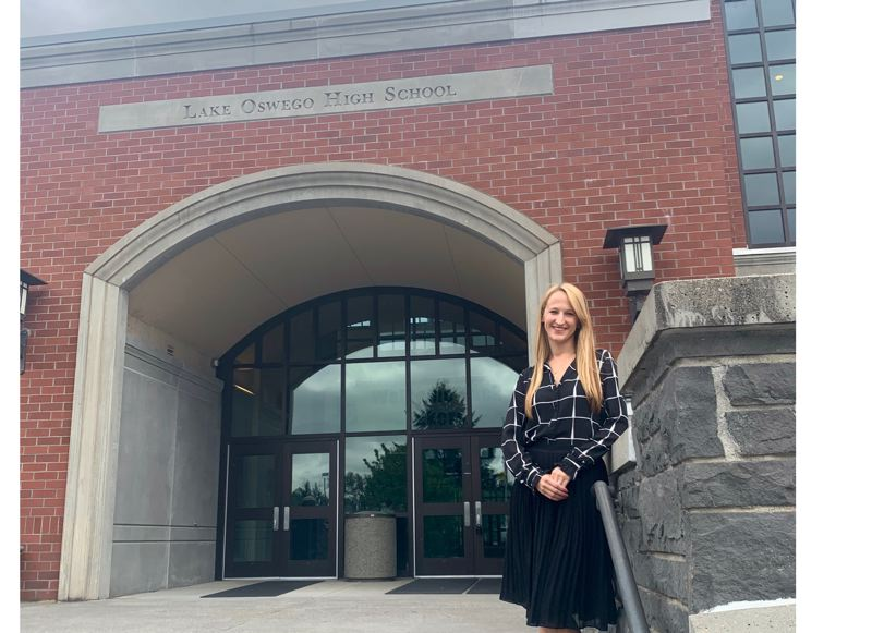 PMG PHOTO: CLAIRE HOLLEY - Caroline Lindsay outside her alma mater, Lake Oswego High School.