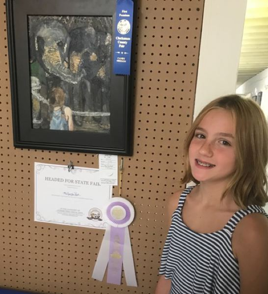 COURTESY PHOTOS - McKenzie Park with her winning piece, My Elephant Friends.