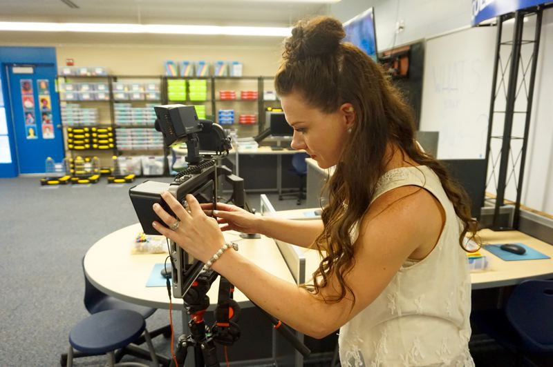 PMG PHOTO: CLAIRE HOLLEY - Nicole Doran starts up an iPad attached to Padcaster, technology used to capture and alter footage on green screens.