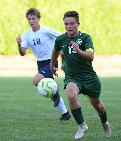 PMG PHOTO: DAVID BALL - Estacadas Niko Snyder chases a ball down the sideline into the attacking zone in the first half.