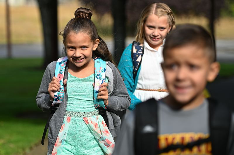 PMG PHOTO: CHRISTOPHER OERTELL - Ruby Ruhl, 8, and classmates walk up to the door for the first day of school at Dilley Elementary School on Wednesday, Sept. 4.