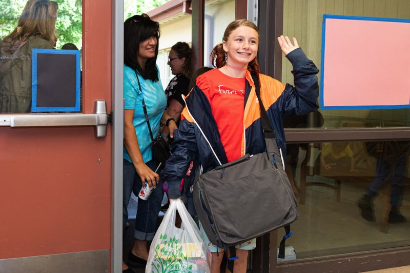 PMG PHOTO: CHRISTOPHER OERTELL - Parents and children walk into Dilley Elementary School on the first day of classes Wednesday, Sept. 4.