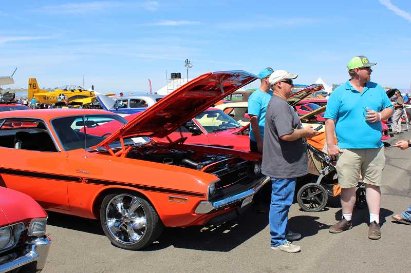 HOLLY M. GILL/MADRAS PIONEER - Dave Cunningham, in gray, next to his 1970 Dodge Challenger RT, won Best of Show at the Airshow of the Cascades Car Show Aug. 23-24. This year's show had 63 entries, up from 44 last year.