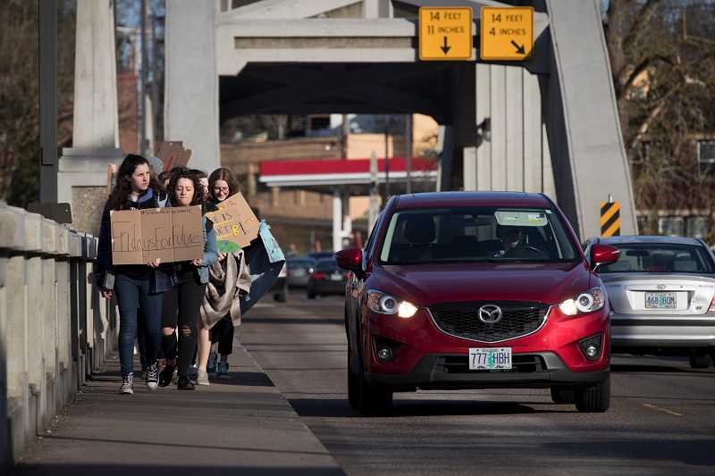 PMG PHOTO: JAIME VALDEZ - Students cross a bridge into downtown Portland during a 2019 youth climate strike, inspired by #FridaysForFuture, a movement sparked by Swedish activist Greta Thunberg.