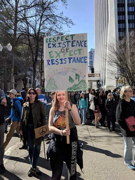PMG FILE PHOTO - Teens march and protest in downtown Portland in March 2019 for a youth climate strike. Another strike, inspired by the Fridays for Future movement, is planned for September 20.