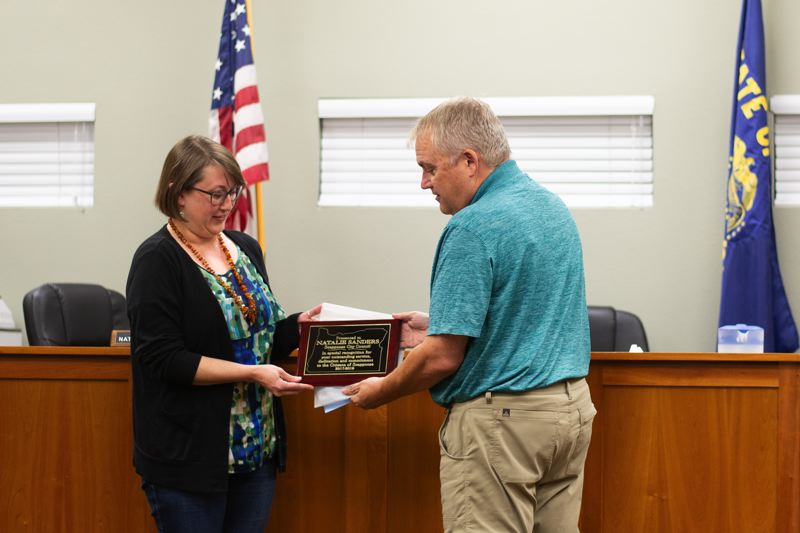 PMG PHOTO: ANNA DEL SAVIO - Scappoose Mayor Scott Burge presented Councilor Natalie Sanders, left, with a plaque at Sanders' final city council meeting on Sept. 3, 2019.