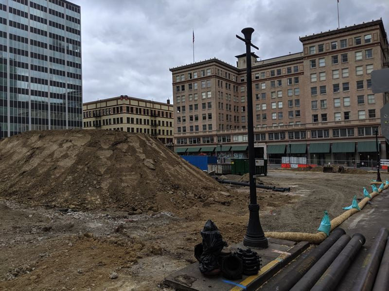 PMG PHOTO: JOSEPH GALLIVAN  - Dirt piles up at the site of the new tower that will host offices, retail, luxury condos and a five star Rizt-Carlton at Southwest 10th and Alder.