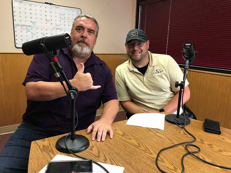 PMG PHOTO: MORGAN URTON - Editor John Baker (left) and Canby High School football coach Jimmy Joyce get ready to talk football.