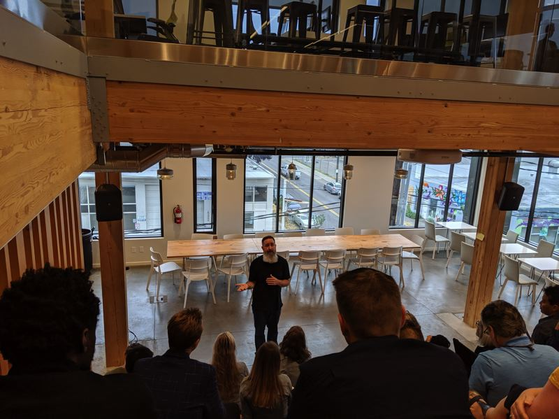 PMG PHOTO: JOSEPH GALLIVAN - Ten years later, Portland Incubator Experiment founder Rick Turoczy is still cultivating tech startups, mostly Software as a Service (SaaS) companies. Here he answers questions from hopeful applicants at an August morning coffee event.