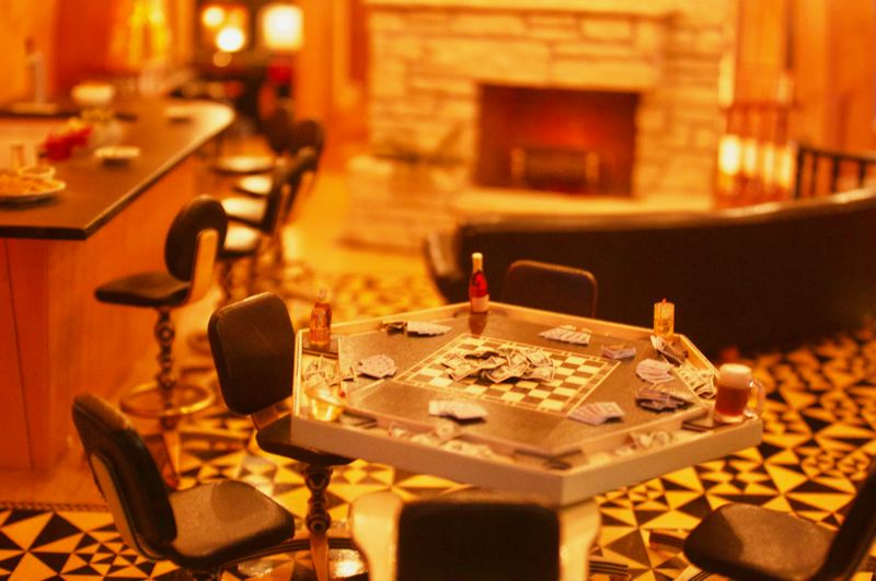 PMG PHOTO: CHRISTOPHER KEIZUR - One room in the Mansion has a poker table and fireplace that flickers with light.