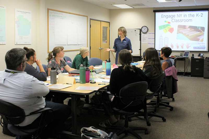 PHOTO COURTESY OF CROOK COUNTY SCHOOL DISTRICT - Jen Hunt works with local elementary school teachers as part of a training to improve math instruction.