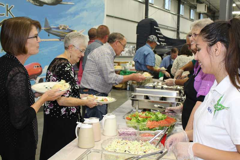HOLLY M. GILL/MADRAS PIONEER - Attendees at last year's chamber banquet visit while getting their dinner.