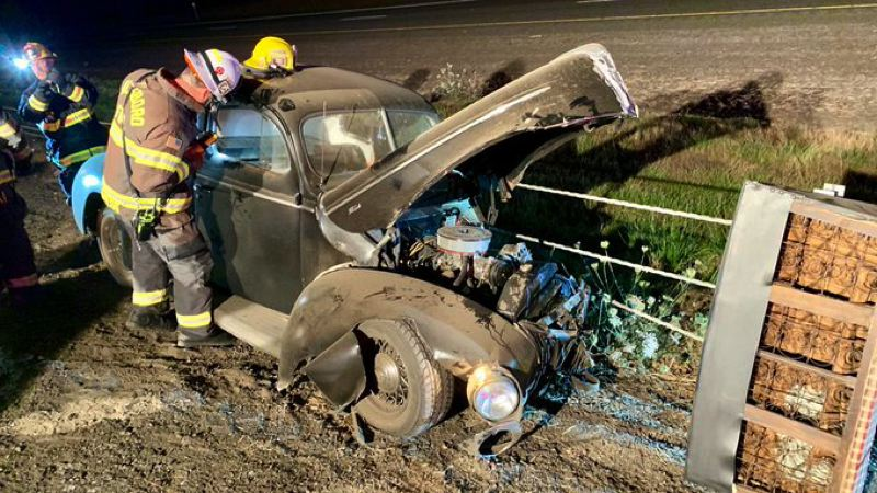 COURTESY PHOTO: WASHINGTON COUNTY SHERIFF'S OFFICE - A 1940s-vintage Ford smashed into several freeway barrier posts along Highway 26 westbound in Hillsboro on Thursday night, Sept. 5. The driver was hospitalized with serious injuries.