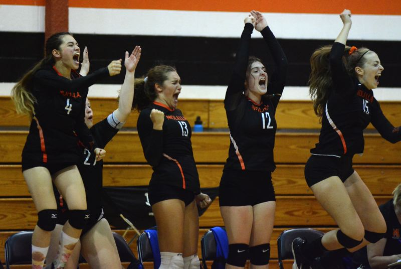 PMG PHOTO: DEREK WILEY - Emma Cortes, No. 4, Stephanie Hall, No. 27, Paula Romero, No. 13, Alyson Wilcox, No. 12, and Kristin Kendall, No. 15, celebrate at the end of Molalla's 3-1 win over Blanchet Catholic Thursday.